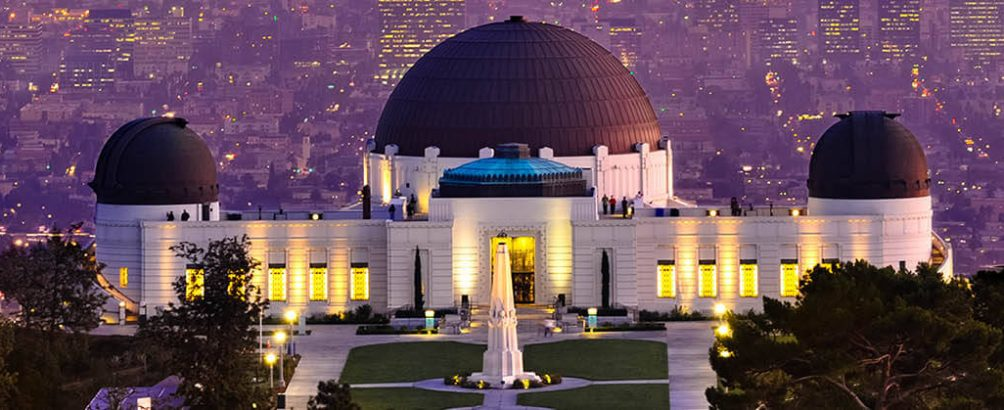 An aerial view of the Griffith Observatory in Los Angeles at sunset.