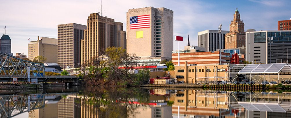 Panoramic view of Newark, New Jersey, cityscape reflecting in the water.