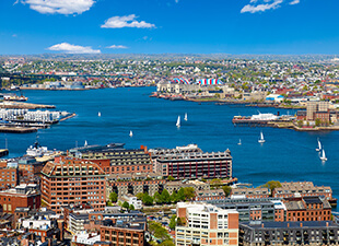 Aerial view of Boston Harbor and Waterfront on a sunny day.