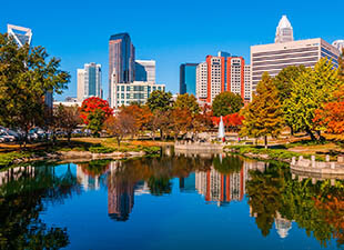The Charlotte skyline from Marshall Park on a sunny, autumn day.