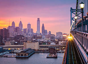 A panoramic view of the Philadelphia cityscape at dawn.