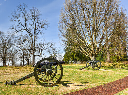 A Civil War battlefield with antique cannons is in Fredericksburg, Virginia on an early spring afternoon.