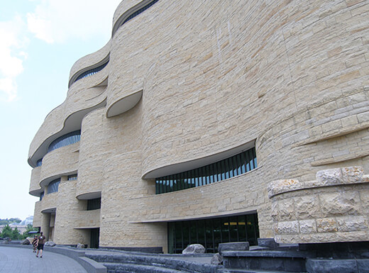 Alt= Daytime view of the Smithsonian National Museum of the American Indian building in Washington, D.C.