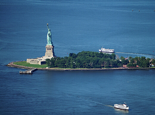Aerial view of the Statue of Liberty in New York City as seen from One World Observatory, one of the best places to view the Statue of Liberty.