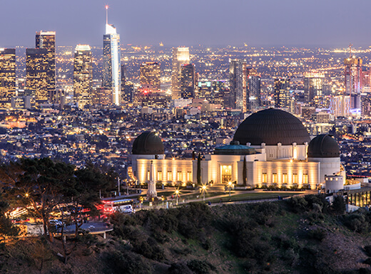 Evening view of Los Angeles city skyline and the Griffith Observatory.