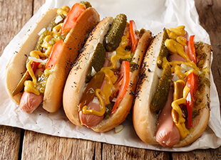 Delicious Chicago style hot dog with mustard, vegetables and relish.