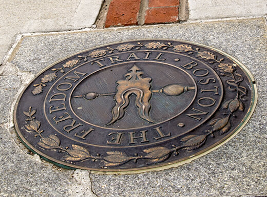 A portion of the red brick line along the Freedom Trail in Boston, Massachusetts.