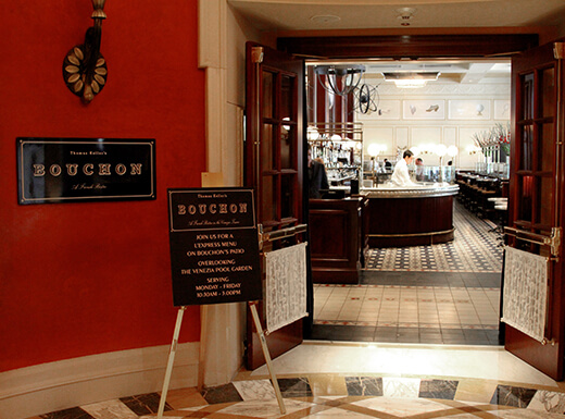A sign showcasing restaurant specials outside the Bouchon during brunch at The Venetian in Las Vegas, Nevada, on a busy morning.