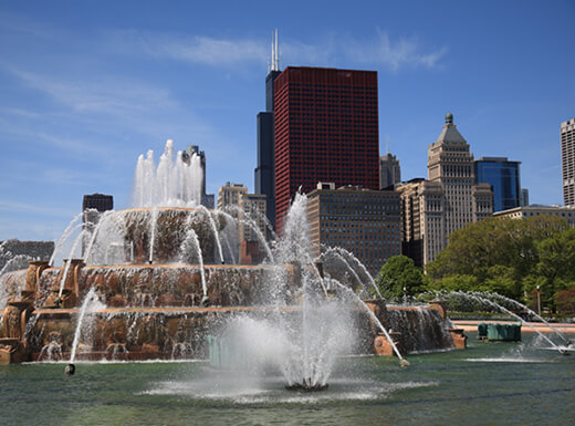 Famous Buckingham Fountain in front of Chicago's skyline on a clear afternoon in Grant Park.