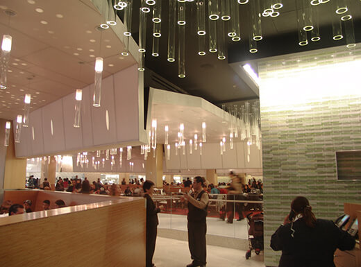 Two servers in the modern interior of Aria Resort and Casino in Las Vegas, Nevada, during a Saturday morning brunch.