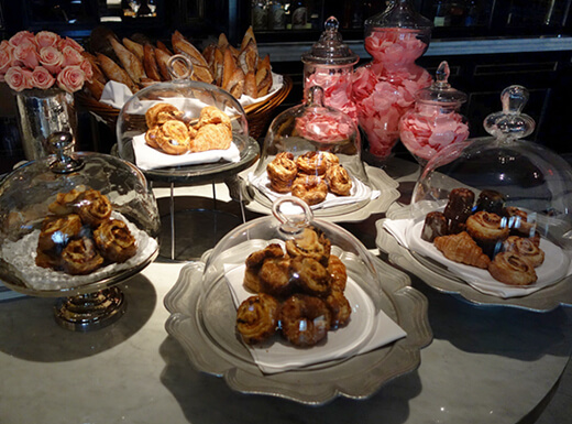 A variety of pastries on decorative plates during brunch at Aria Resort and Casino in Las Vegas, Nevada.